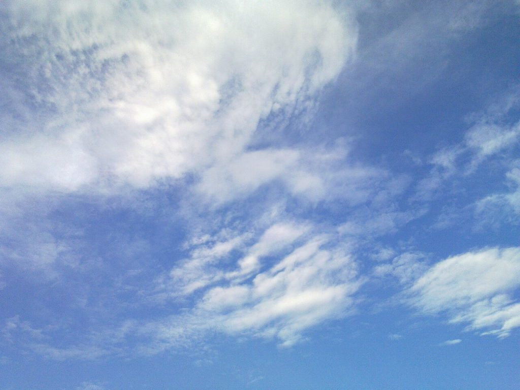 Blue sky with wisps of clouds
